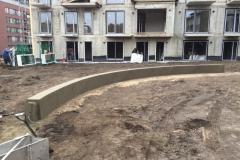 lenktos formos betono sienele
